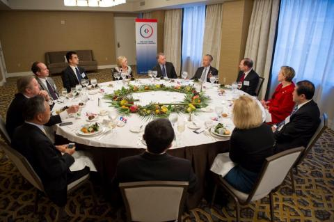 Members of USCBC's board of directors talk with Amb. Cui at a welcome dinner hosted by USCBC.